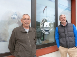 Hammerfest old and new: tourism office manager Knut Arne Iversen (right) celebrates Hammerfest's new gas boom, while his father Knut (left) remembers the destruction of 70 years ago. Picture: Vincent Hunt